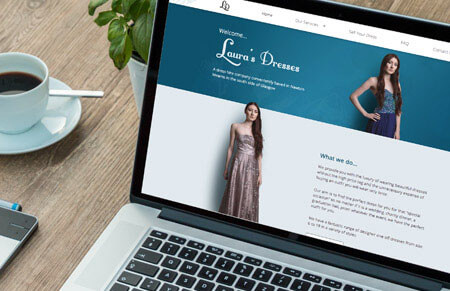 Laura's Dresses viewed on a laptop